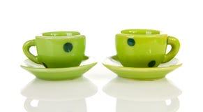 Copos pontilhados verde dos utensílios de mesa Imagem de Stock Royalty Free