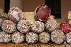 Coppa. Some salami on a table Stock Photos