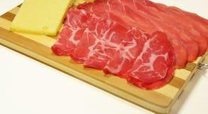 Coppa da salpicadura e queijo italianos de Asiago Foto de Stock