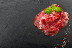 Coppa di Parma ham. With fresh basil Royalty Free Stock Images