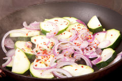 Copped courgette, red onion and dried chili Stock Photos