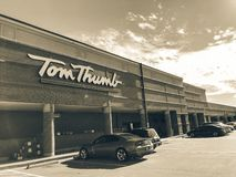 Filtered tone entrance of Tom Thumb grocery store under cloud bl stock photo