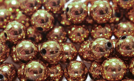 Copper beads. Background of shiny copper beads Royalty Free Stock Photos