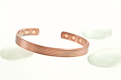 Copper bracelet and stones Royalty Free Stock Photography