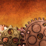Copper and brass gear on the gold metallic wall. Royalty Free Stock Photography