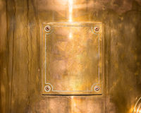 Copper or bronze frame with rivets Royalty Free Stock Photo