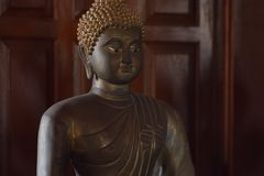 Copper of buddish state in the art style ,Wat Krathum Suea Pla t. Emple ,Bangkok Stock Photo