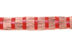 Copper cable lines with red ribbon Stock Image