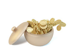 A copper canister and gold coins Stock Images