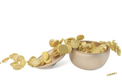 A copper canister and gold coins Stock Photos