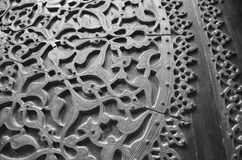 Copper carved door. A copper carved door of an old islamic historic mosque in black and white effect stock photos