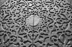 Copper carved door. A copper carved door of an old islamic historical mosque in black and white effect royalty free stock photography