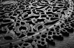 Copper carved door. A copper carved door of an old islamic historical mosque in black and white effect royalty free stock images