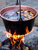 Copper cauldron with the tasty mulled wine Stock Photo