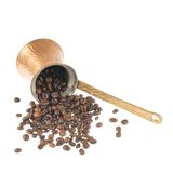 Copper cezve and coffee beans Stock Image
