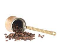 Copper cezve and coffee beans Stock Photo