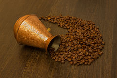 Copper cezve for coffee with coffee beans Royalty Free Stock Photo