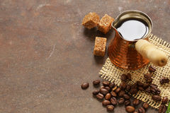 Copper cezve coffee and grains Stock Photos