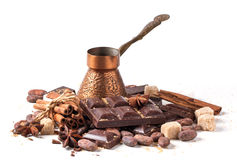 Copper cezve with dark chocolate and cocoa beans Stock Photos