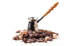 Copper cezve with dark chocolate and cocoa beans Royalty Free Stock Image