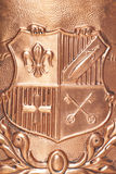 Copper coat of arms Royalty Free Stock Photo