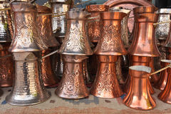 Copper coffee boilers. Traditional BosnianTurkish copper coffee boilers on sale on the market royalty free stock photo