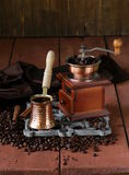 Copper coffee pot with beans. On a wooden table Royalty Free Stock Photography