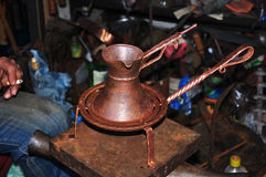 Copper coffee pot, cup. Holder, hand forging Stock Photo