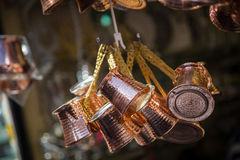 Copper coffee pots. Close up photo of a bunch of copper coffee pots hanged up in a market in Istanbul Royalty Free Stock Photos