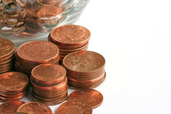 Copper Coins. Stacked money in front of savings jar royalty free stock photos