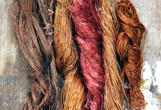 Copper. Colorful copper scrap wires on wooden background Royalty Free Stock Image