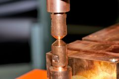 Copper contacts of electric welding machine. Small depth of sharpness stock photography