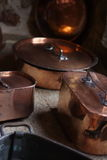 Copper cookware. Cookware pots and casseroles made of coper in a french middle age castle stock photo