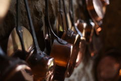 Copper cookware. Cookware pots and casseroles made of coper in a french middle age castle stock image
