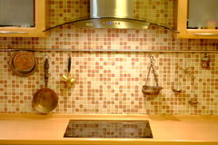 Copper cookware on kitchen wall. Stock Images