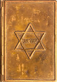 Copper cover of an old Jewish prayer book. As background Royalty Free Stock Photo