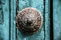 Copper decoration on the old door in Cuzco. Copper door decoration on the old door of the temple in Cuzco, Peru royalty free stock photography