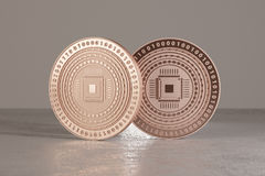 Copper digital coins on metal floor as example for bitcoins, fin-tech or online-banking.  Royalty Free Stock Image