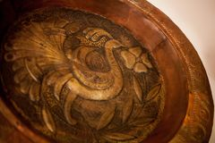 Copper dish with hammering royalty free stock photography