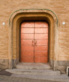 Copper door. Shiny copper door on a building stock photo