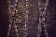 Copper door. Background of ancient grunge copper door royalty free stock image