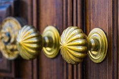 Copper door handles shot close-up. Against the door royalty free stock photos
