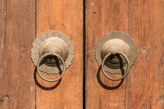 Copper door knocker. Closeup of a pair of copper door knockers stock photo