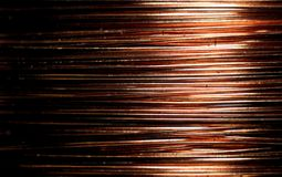 Copper coil with contactor in macro, copper background. Copper is an element of the eleventh group of the fourth period of the periodic table of chemical stock image