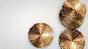 Copper eos coins falling on white background. Animation stock footage