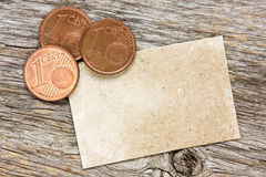 Copper euro cents with paper card Royalty Free Stock Photo