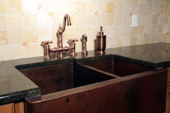 Copper Farm Sink. This is an image of a copper farm sink and faucet stock image
