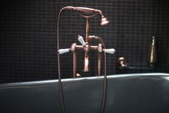 Copper faucet mixer with porcelain handles. Stylized antique, shower in the bathroom stock photos