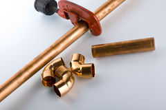 Copper fittings. And pipe with clipper Royalty Free Stock Images