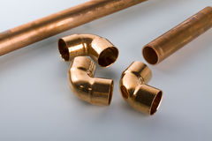 Copper fittings. And red pipe Royalty Free Stock Images